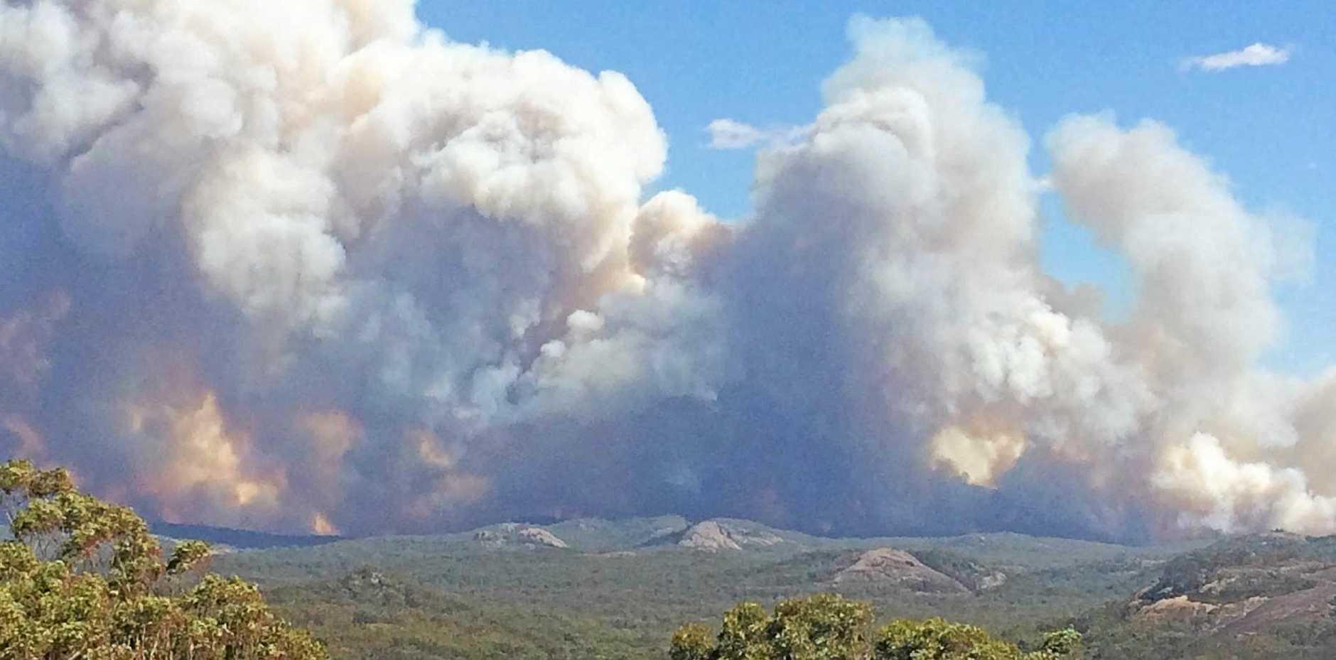 Wallangarra fire burns off in the distance.