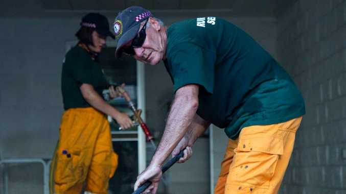HELPING HAND: Gladstone region RFS volunteer Al Mason helping clean up Townsville after floods.