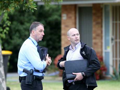 Detectives at the home on Clayton Road in Oakleigh East. Picture: Yuri Kouzmin