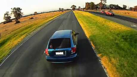 The truck quickly approaches the car and appears to attempt to stop. Picture: Dash Cam Owners Australia/ Facebook.