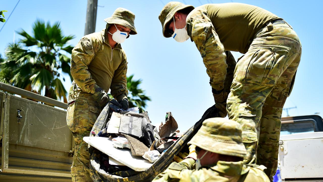 Troops from the Australian Defence Force helping clean up Townsville suburbs affected by the Townsville floods. LBDR Christan Hughes and GNR Zac Bradbery