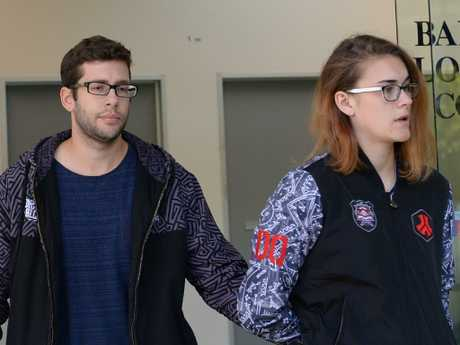 Jakob Thornton, 22, and his girlfriend leave Bankstown Police Station where he has to report for bail conditions. Photo Jeremy Piper