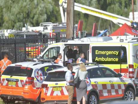 Family and workmates at the scene of where a man was electrocuted in Moorebank. Picture: Jeremy Piper