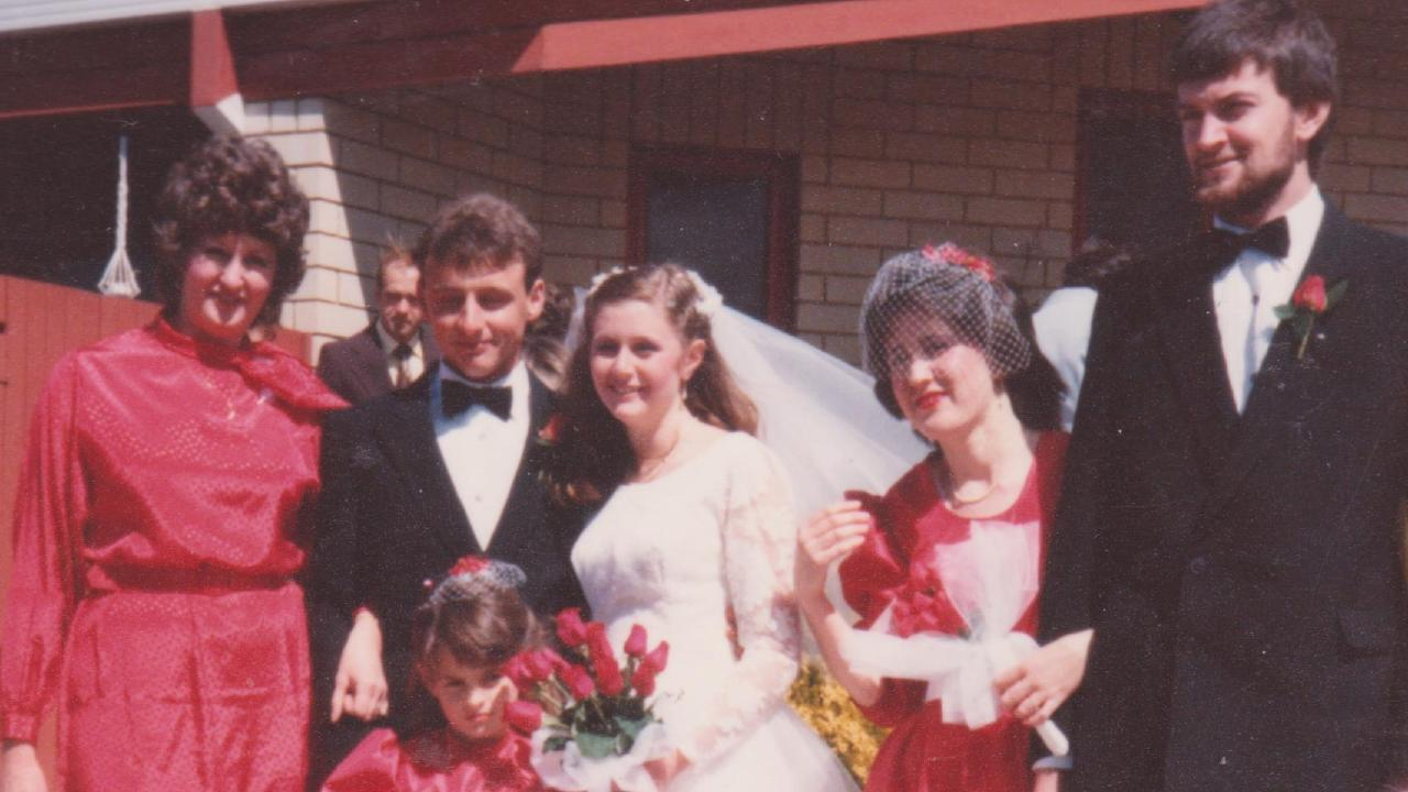 Patricia and Edmund Ian Riggs (centre) on their wedding day in 1984