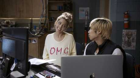 Jessica Rothe and Phi Vu in a scene from Happy Death Day 2U.