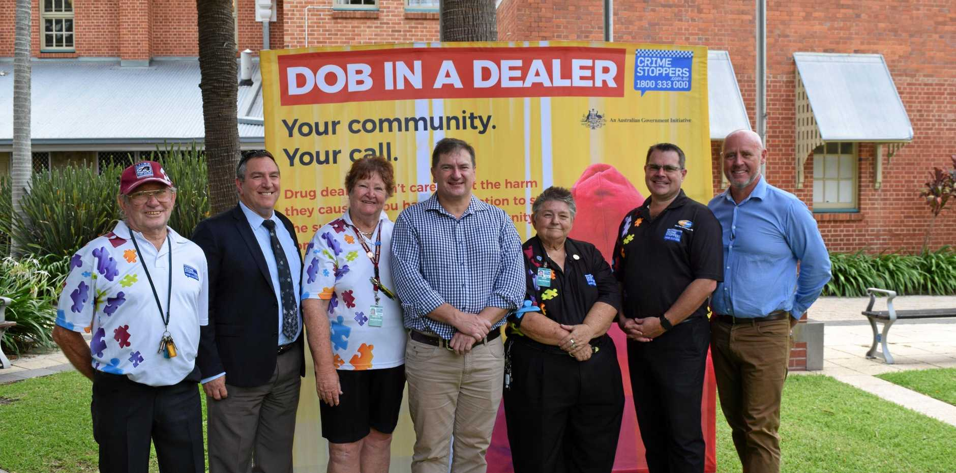 STOP THE SUPPLY: Crime Stoppers volunteer Perry Perrement, Wide Bay Burnett district detective Inspector Gary Pettiford, CS volunteer Roz Kemp, Federal Member for Wide Bay Llew O'Brien, CS volunteer Kris McHugh, CS general manager Johnathon Cowley and Cr Darren Everard at the launch of Dob in a Dealer on the Town Hall green in Maryborough.