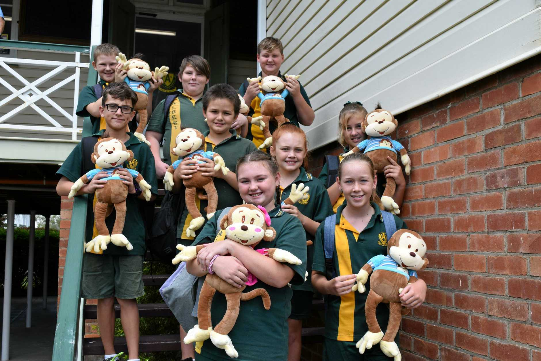 Albert State School student leader nominees (back from left) James Reece, Stephen Harcla, Zac Hughes, (middle from left) Lachlan Haigh, Jayden Treweek, Matilda Harrison, Sierra Pursey, (front from left) Taryn Smith and Kayleigh Hodder with the backpacks and stuffed monkeys donated by the Rotary Club of Maryborough Sunrise.