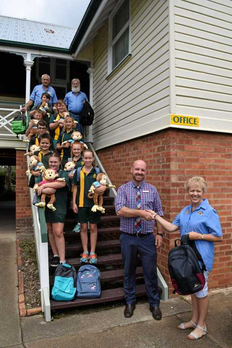 GRATITUDE: Albert State School principal Phillip Murtagh, with student leader nominees James Reece, Stephen Harcla, Zac Hughes, Lachlan Haigh, Jayden Treweek, Matilda Harrison, Sierra Pursey, Taryn Smith and Kayleigh Hodder, accepted the donation of backpacks and stuffed monkeys donated from Rotary Club of Maryborough Sunrise members Robyn Dowling (front right) and (back from left) Ron McLean and Willy Paes.