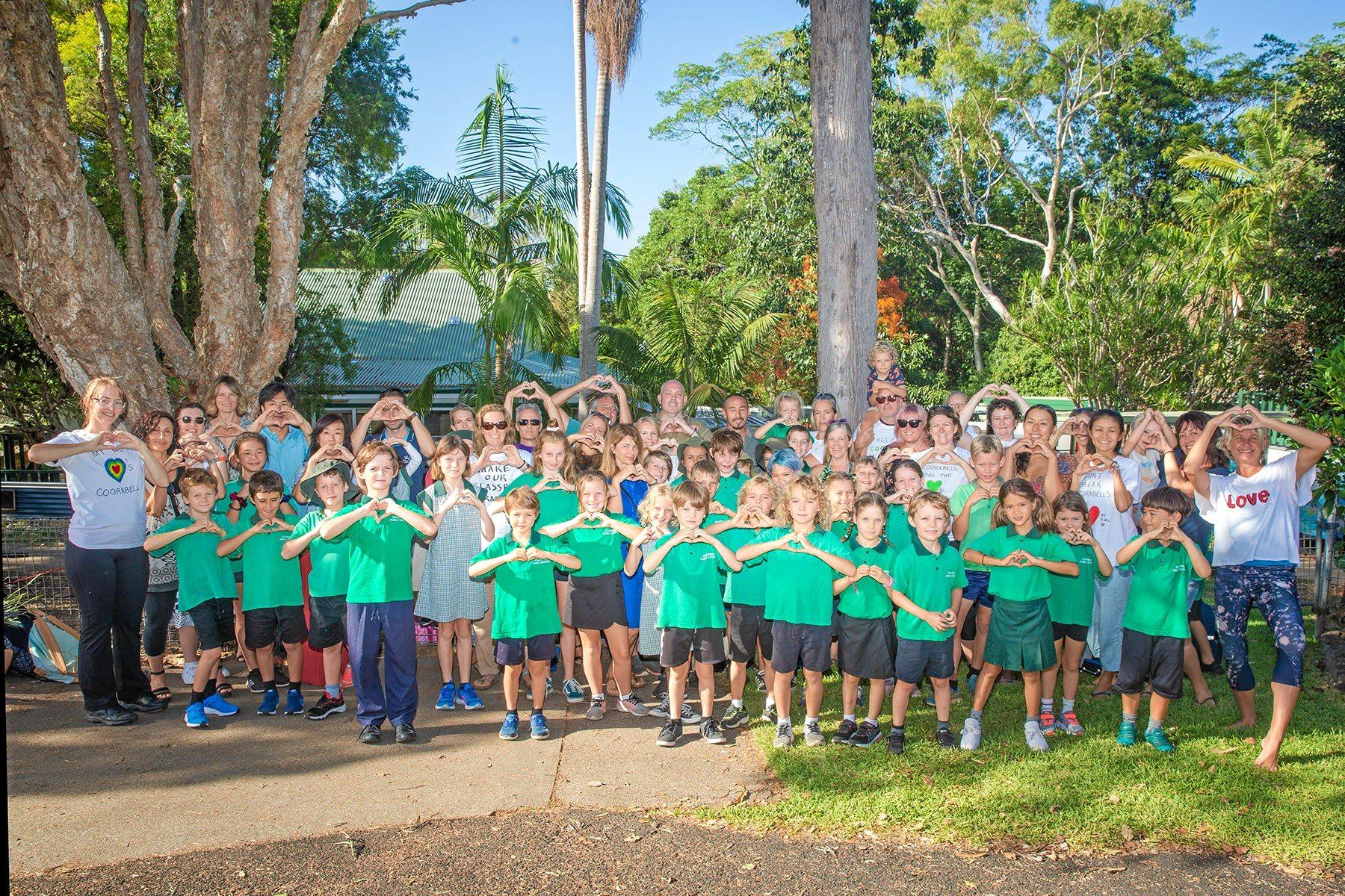 SCHOOL LOVE: Coorabell students and their parents rally outside their beloved school.