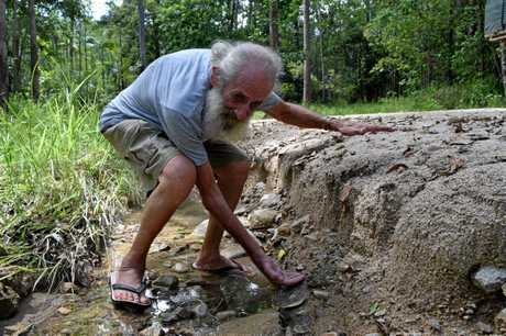 Finch Hatton Gorge Rd resident 'Wazza' Swadling said his road was washed away by last week's heavy rains. He is calling on Mackay Regional Council to replace the unsealed road with concrete.