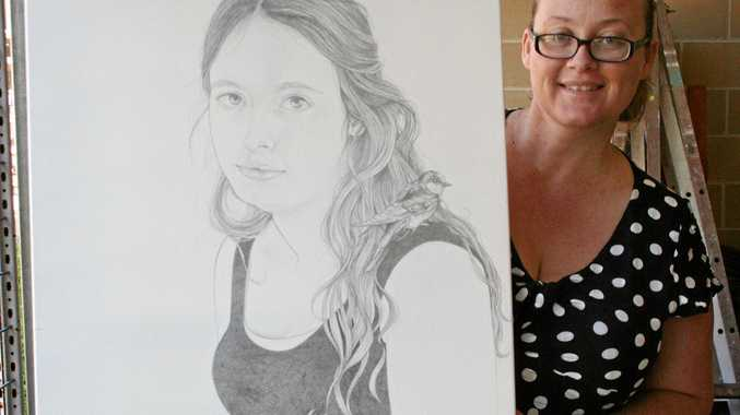 CREATIVE HANDS: CQUni student Elisha Habermann with one of her artworks.