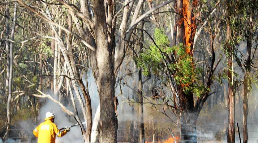 Queensland Rural Fire Brigade work to contain the fire in Girraween National Park near Wallangarra.