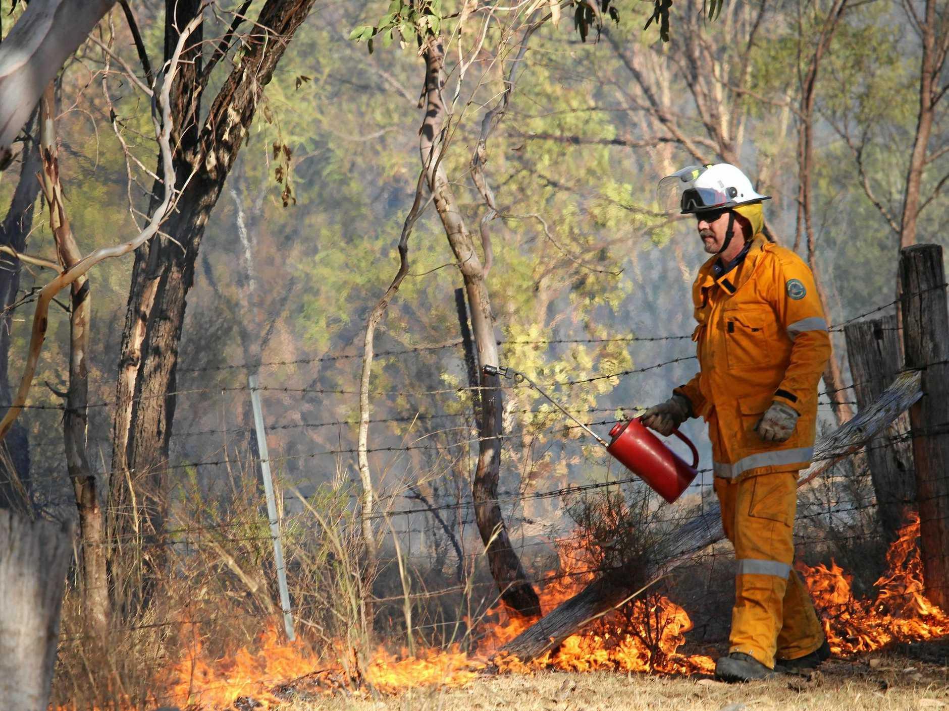 ON THE JOB: Hugh Strong performs back-burns in Girraween National Park near Wallangarra.