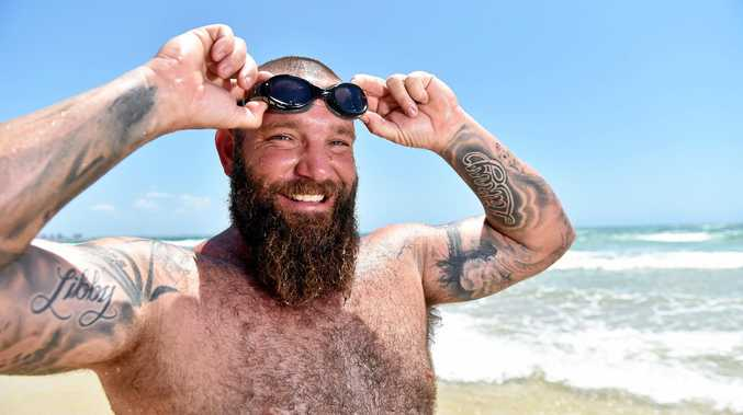 Coast tradie Gary Latimer will swim 11km Mudjimba to Mooloolaba to raise money for his daughter Summer to get a Smart Pup, she has autism and struggles everyday to cope.