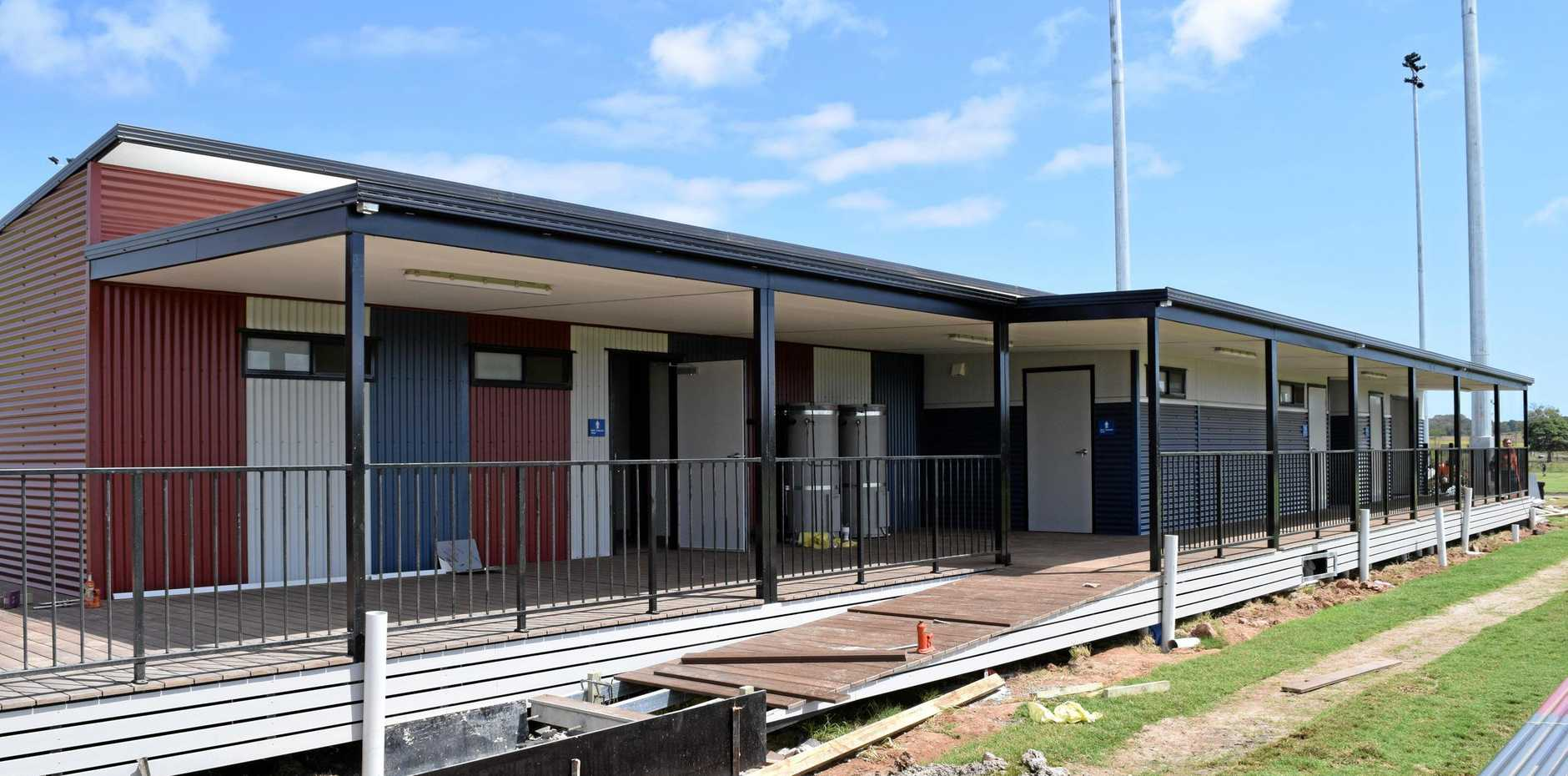 NEARING COMPLETION: Workers are putting the final touches on the clubhouses at the Sports Precinct ahead of the community opening day this weekend. Sport clubs will fit out the clubhouses once completed.