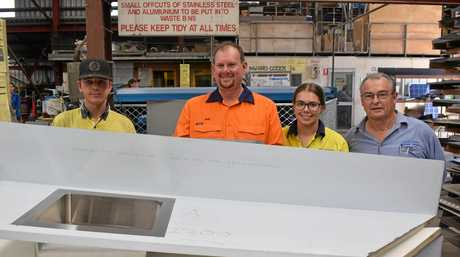 BUY LOCAL: Apprentice Kirby Gleeson (left), Labor's Candidate for Capricornia Russell Robertson, recently qualified apprentice Megan Benson and business owner Glen Adams at Adnought Sheet Metal Fabrications to promote Labor's local procurement policy.