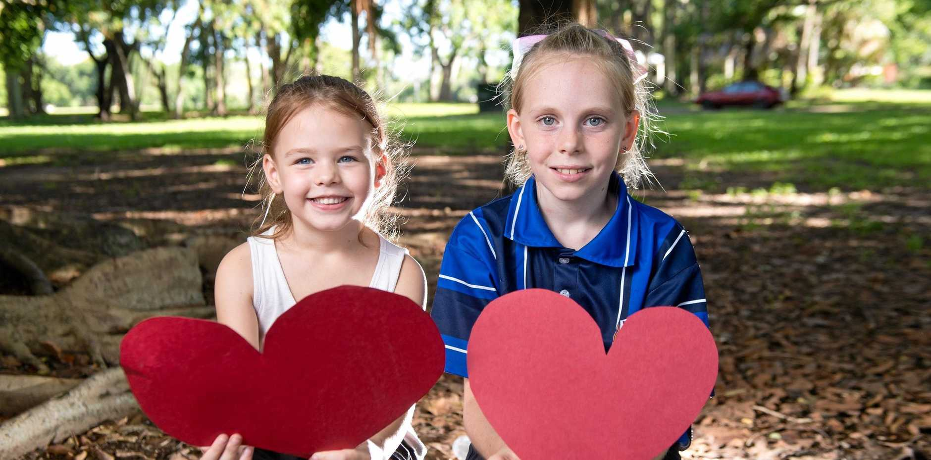 VALENTINES DAY: Lexi Frangelton, 6, and Rhyli James, 10, at Queens Park.