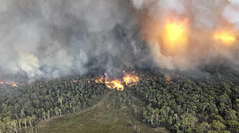 BIRDS EYE VIEW: An aerial shot of the fire burning through Girraween National Park.
