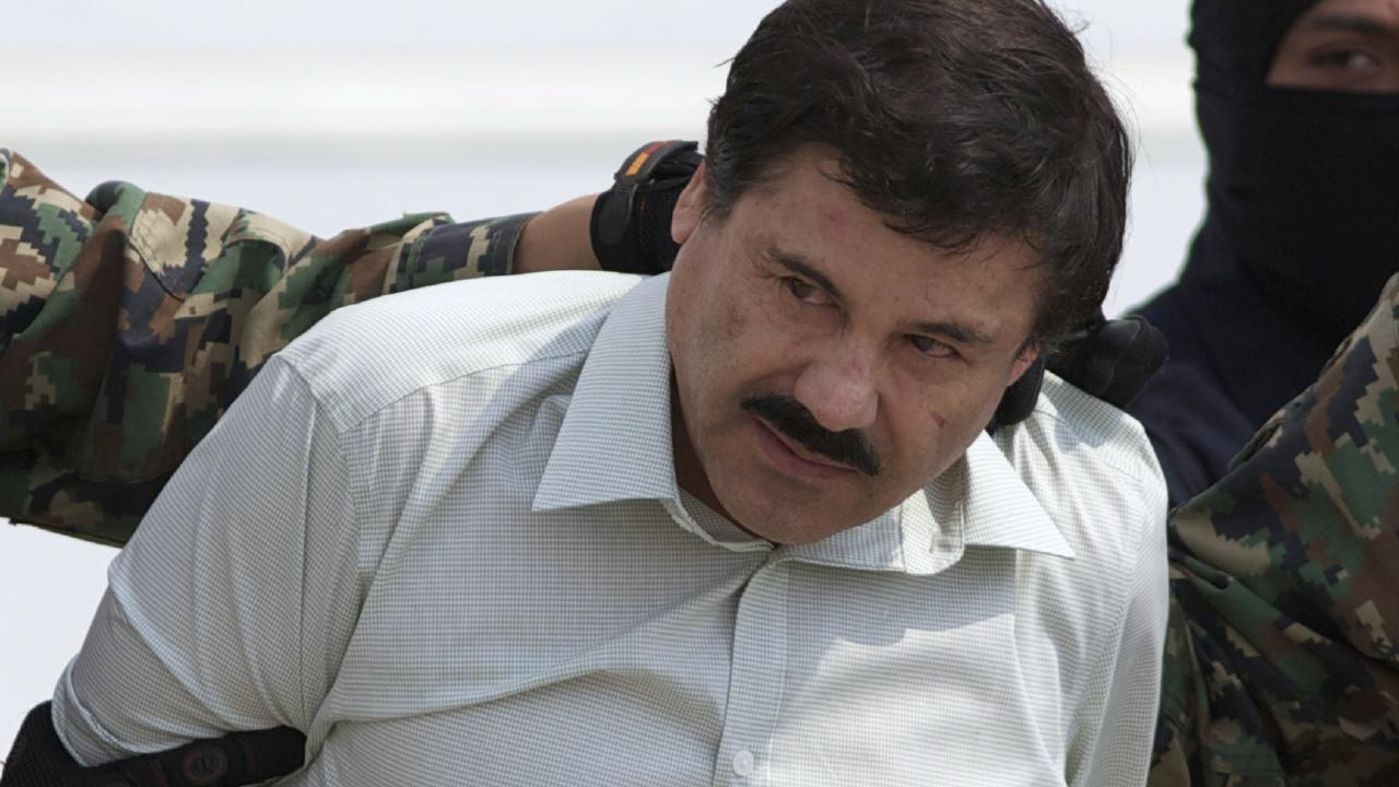 Joaquin 'El Chapo' Guzman, the head of Mexico's Sinaloa Cartel, being escorted to a helicopter in Mexico City following his capture in the beach resort town of Mazatlan in February 2014. Picture: AP Photo/Eduardo Verdugo, File