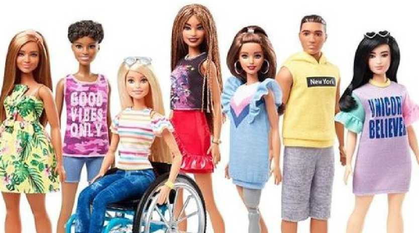 Barbie introduces dolls with wheelchairs and prosthetic limbs.