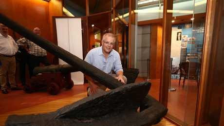 Prime Minister Scott Morrison with the recovered anchor from Captain Cook's Endeavour in the James Cook Museum in Cooktown. Picture: Brendan Radke