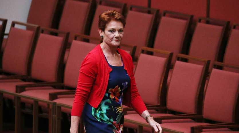 Senator Pauline Hanson walks out of the Senate. Picture Gary Ramage