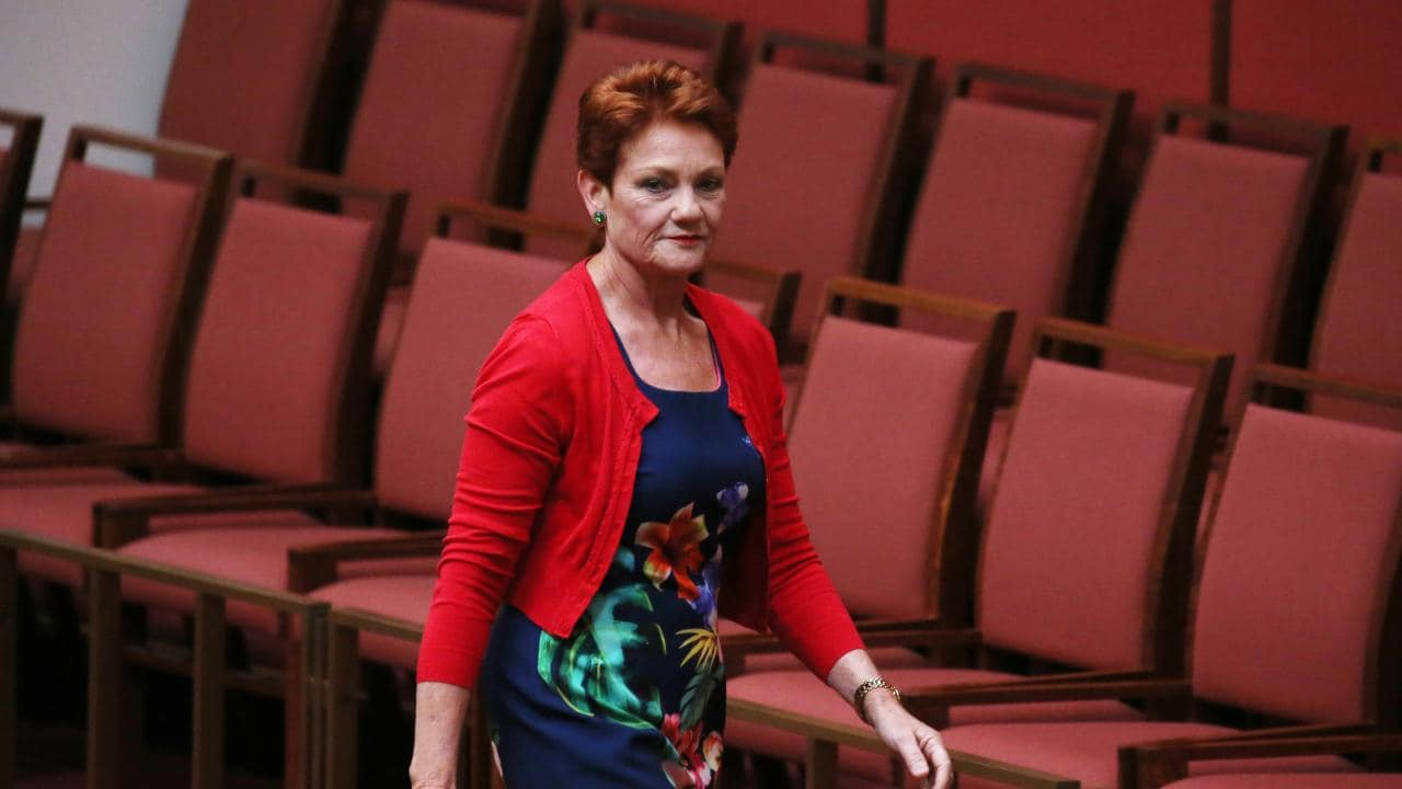 Senator Pauline Hanson walks out of the Senate. Picture Gary Ramage