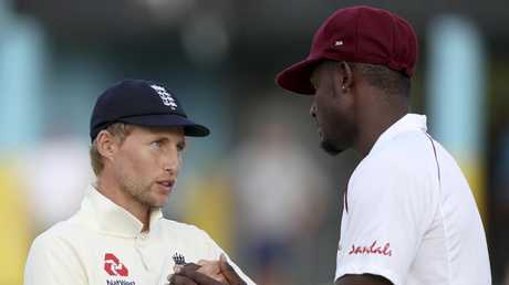 England's captain Joe Root and West Indies' captain Jason Holder shake hands. Picture: AP