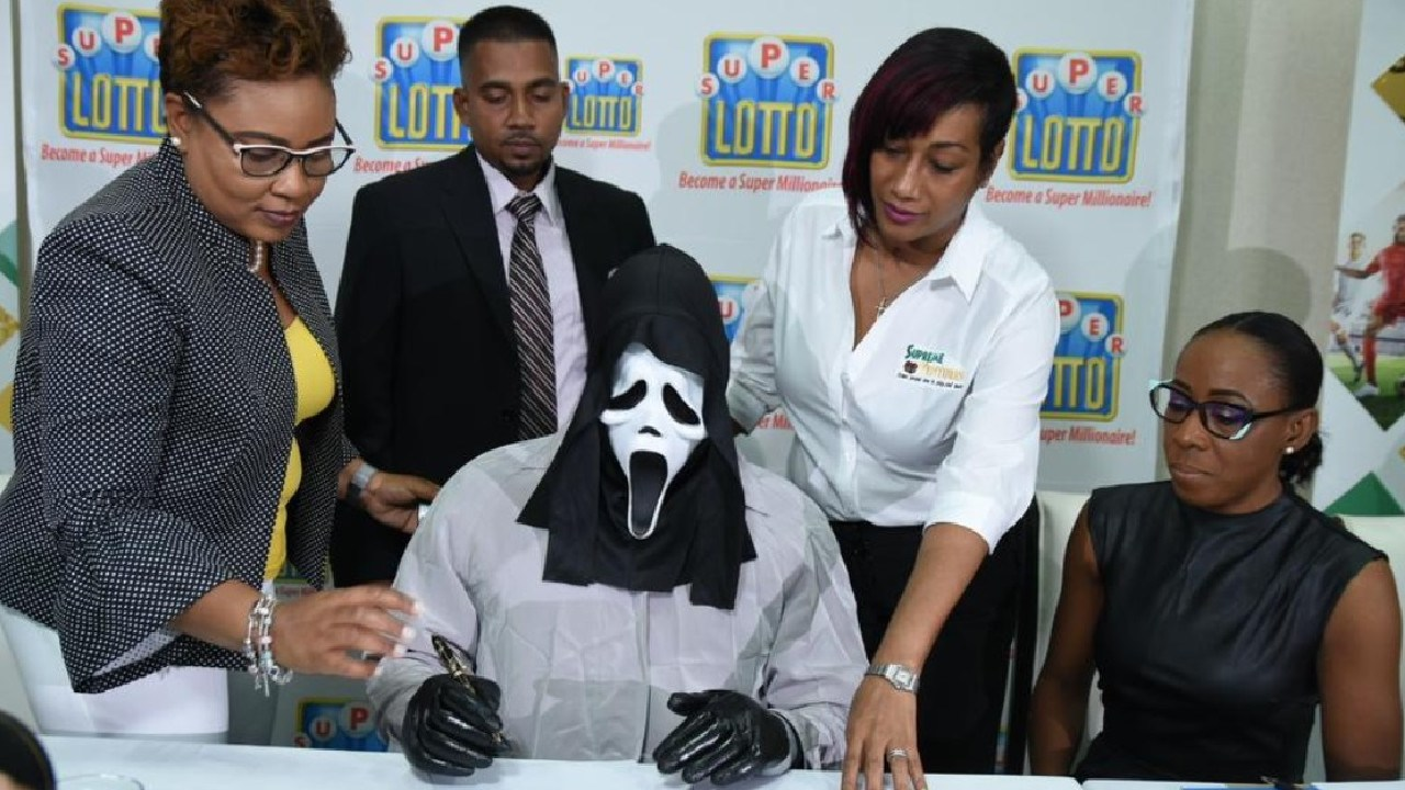 Apparently it is common for Jamaican lottery winners to wear costumes when claiming their prize. Picture: Twitter @SVLGrp