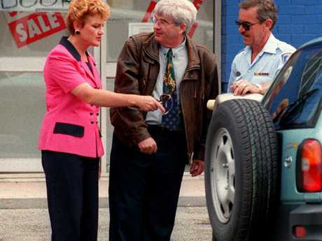 Ms Hanson attempts to help Mr Burston over a parking ticket at Cessnock in this undated picture.
