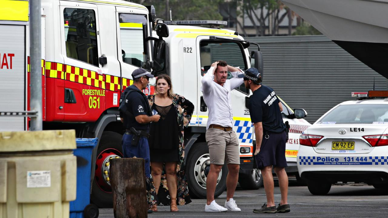 Distressed guests of the All Occasions party cruise speak to police after the boat docked at White Bay. Picture: Adam Yip