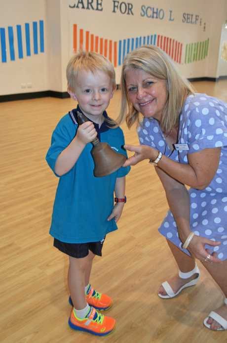 GREAT START: Student Grayson rings the school bell for the first time with principal Sharyn Rieger.