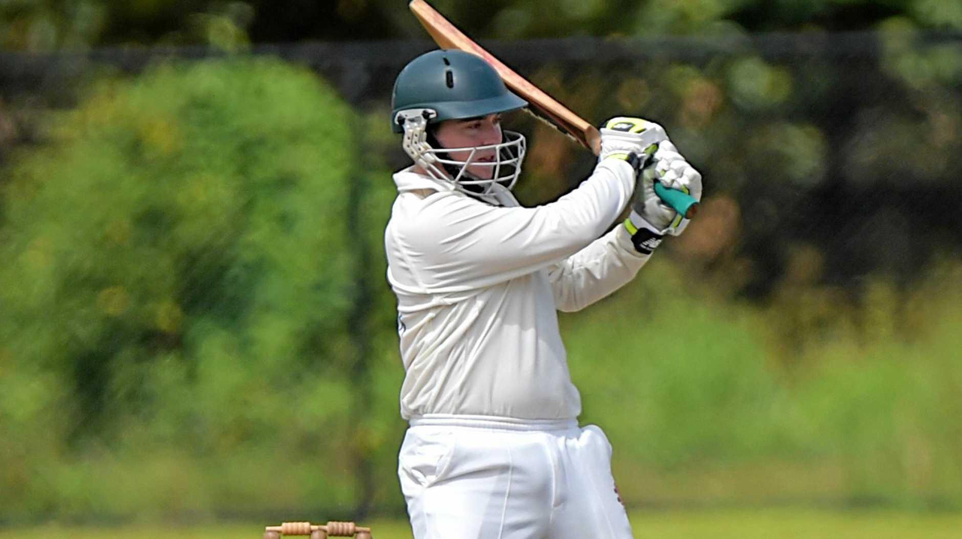 FULL SWING: Glasshouse batsman Daniel Cahill on the attack.