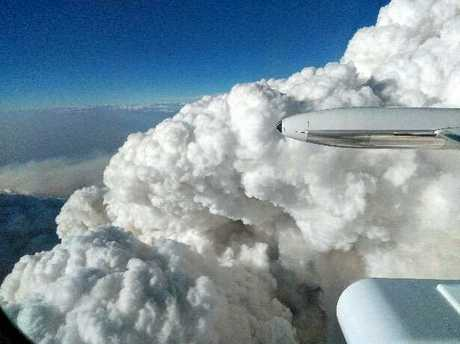 The view of the smoke at the Wallangarra Fire from a waterbombing pilots perspective.