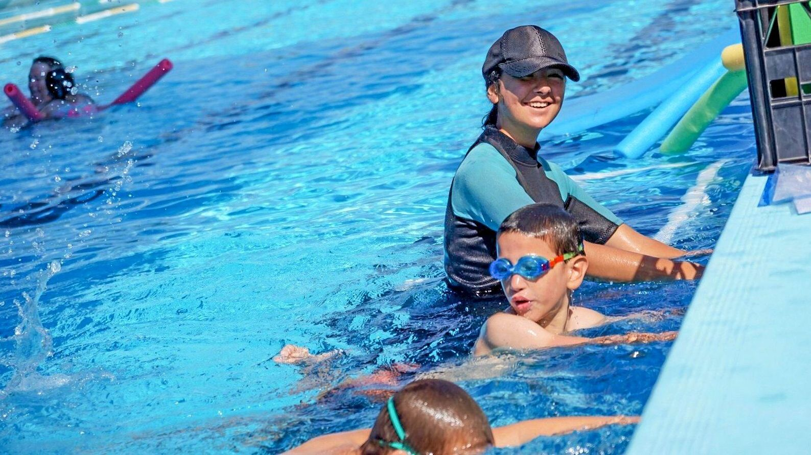 BIG NUMBERS: Jovy Griffin taught Learn2Swim to big numbers yesterday, as the temperature soared to a record.