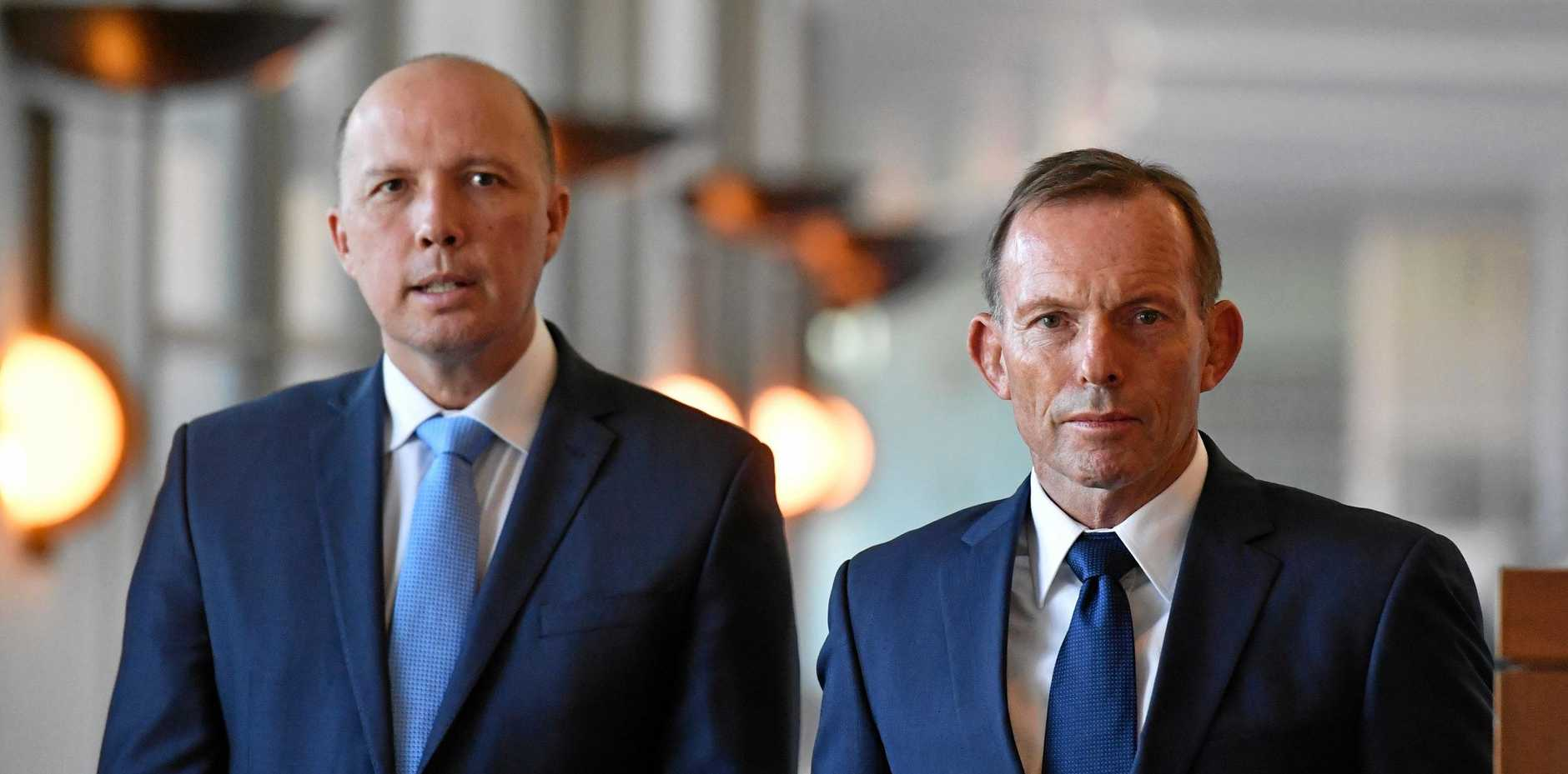 Minister for Immigration Peter Dutton and former prime minister Tony Abbott.