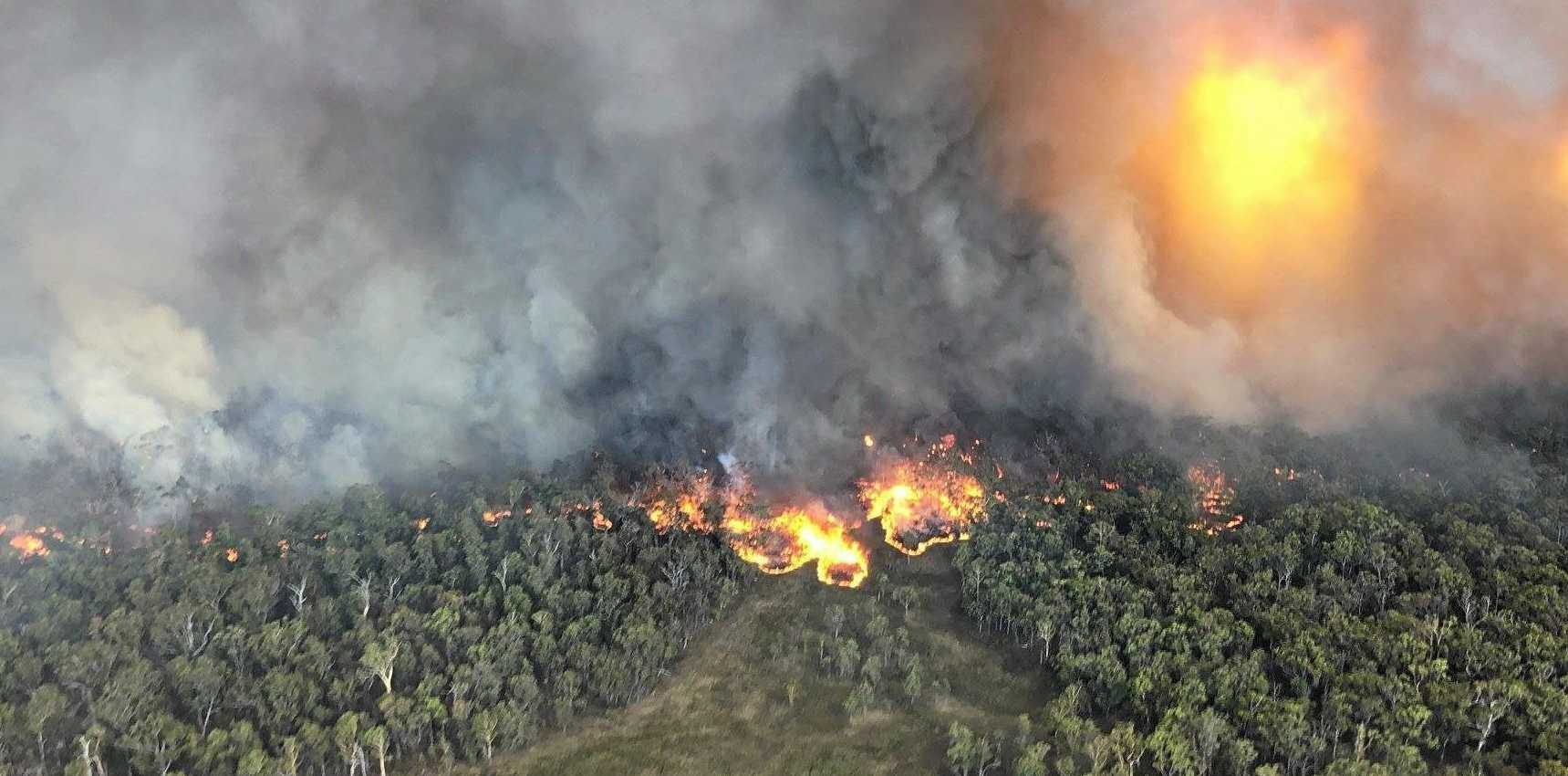 CLOSE WATCH: An aerial view of the bushfire near Wallangarra burning in the Girraween National Park on the Queensland-NSW border.