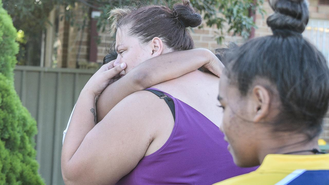 Samantha Rowlands (centre) being comforted after her son's death. Picture: Flavio Brancaleone