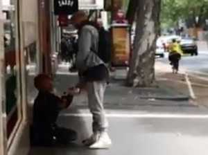 Cooper's classy act with homeless man
