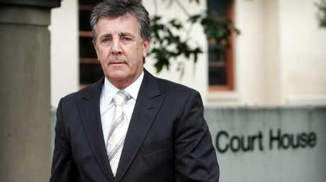 Judge Paul Conlon argues any decision to suspend de Belin could affect the court case.