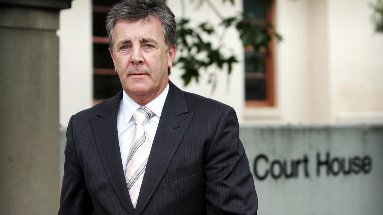 Judge Paul Conlon argues any decision to suspend de Belin could affect the court case.