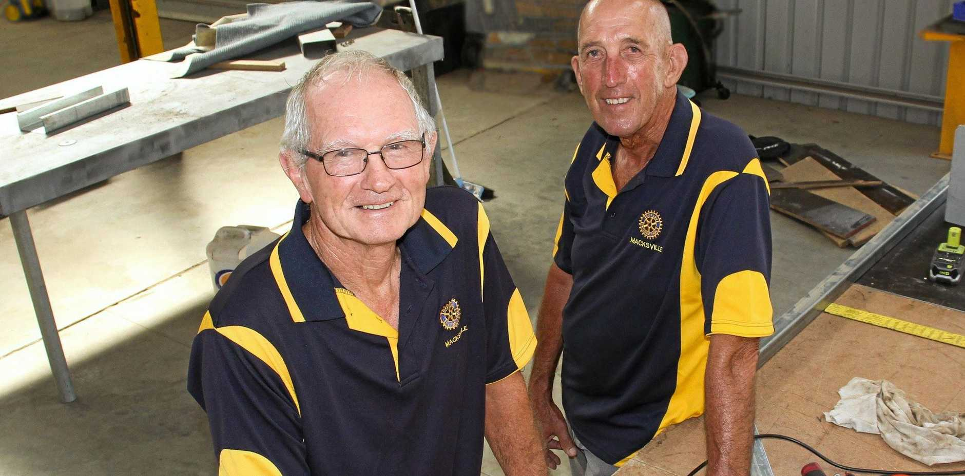 MUSTERING UP: Rod Edwards and David Ainsworth of Macksville Rotary Club work on the new stage ahead of the first ever Macksville Music Muster.