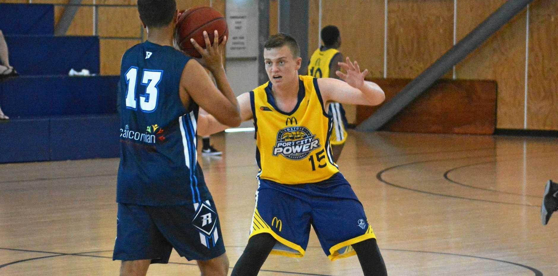 ON GUARD: Biloela-based Gladstone under-16 basketball representative player Owen Gardiner defending against Rockhampton last weekend.