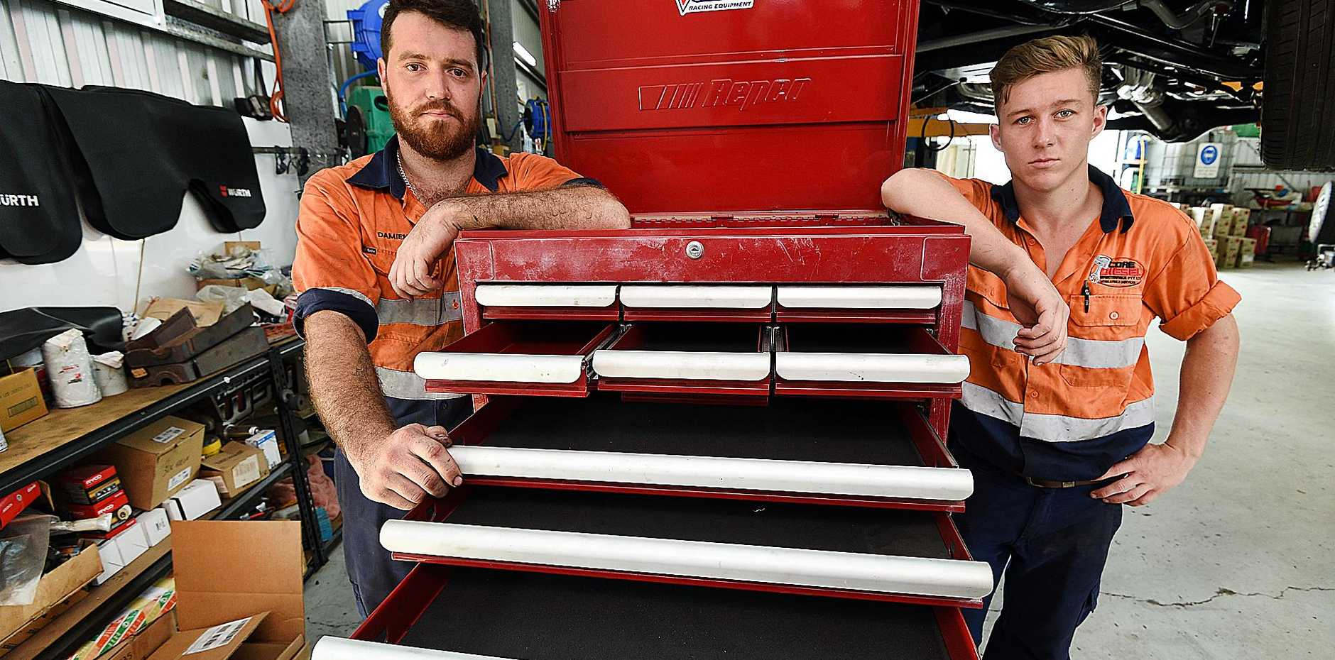 Core Diesel Maintenance at Tinana had over $50,000 worth of tools stolen.  Technician Damien Hughes and 3rd year apprentice Laine Barsby are pictured with with one of the empty tool boxes in the workshop.