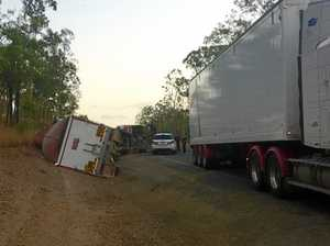 PHOTOS: Truck rollover on Burnett Highway