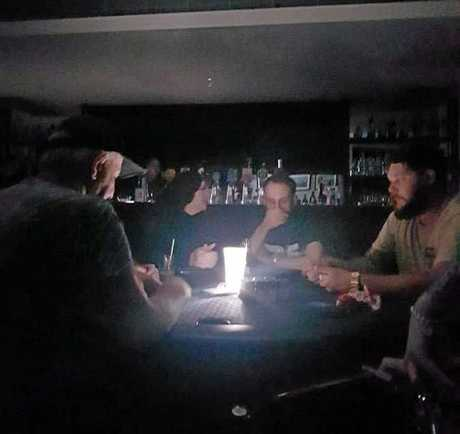 APL Gladstone poker players had to play with the aid of lamps at the Reef Hotel after a blackout affected the CBD on Valentine's Day night.