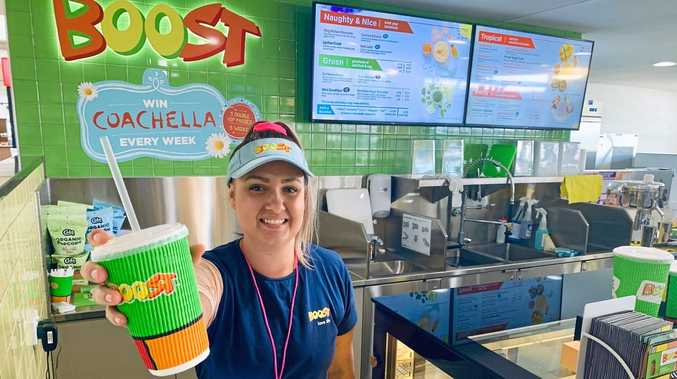 NEW EATERIES: Gemma Cole works at Boost inside the Mackay Airport. The juice bar is one of four new eateries at the airport.