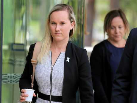 Dr Angela Jay walks into the inquest into the shooting death of Paul Lambert at Coffs Harbour Courthouse.