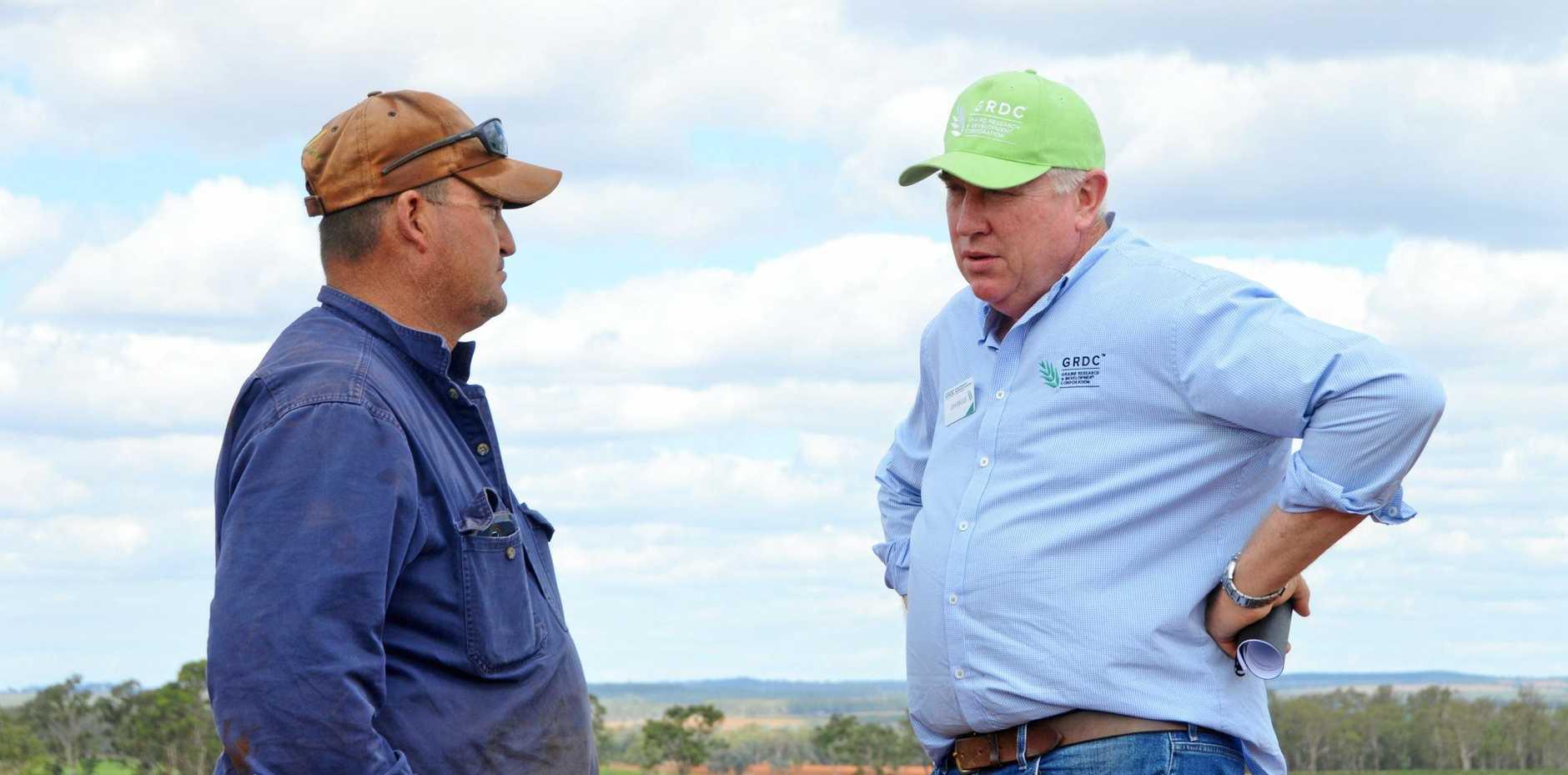 TALKING TRIALS: Farmer Peter Howlett on his farm with GRDC Northern Panel chairman John Minogue.