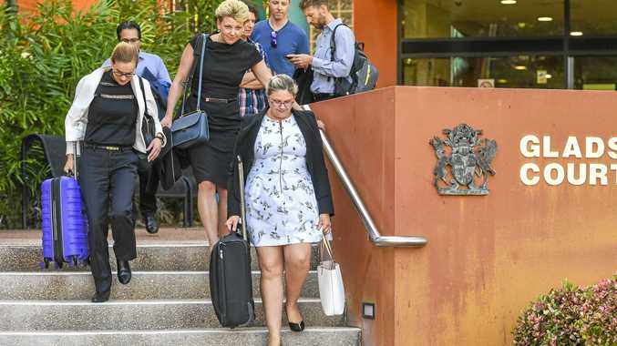 MISSING PLATES: Defence lawyer April Freeman  with Orica employees, including Sarah Jones who pleaded guilty on behalf of the company.